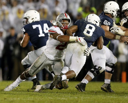 Ohio State defensive end Chase Young tackles Penn State running back Miles Sanders on 4th down to clinch the 27-26 win at Beaver Stadium in University Park, Pa., on Saturday, Sept. 29, 2018.