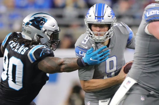 Detroit Lions quarterback Matthew Stafford is sacked by Carolina Panthers defensive end Julius Peppers in the second half on Sunday, November 18, 2018 at Ford Field.