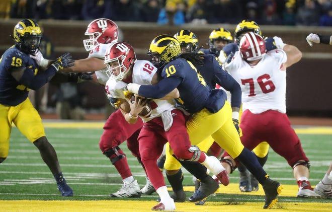 Michigan's Devin Bush sacks Indiana's Peyton Ramsey during the second half Saturday, Nov. 17, 2018 at Michigan Stadium in Ann Arbor.