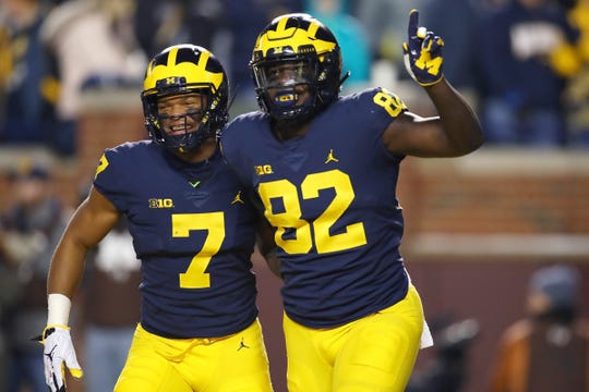 Michigan's Nick Eubanks, right, celebrates a first-half touchdown with Tarik Black against Indiana at Michigan Stadium on Nov. 17, 2018 in Ann Arbor.