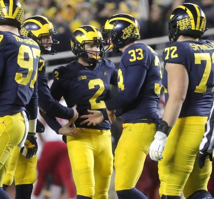 Michigan's Jake Moody (2) is congratulated by teammates after a second-half field goal against Indiana, Saturday, Nov. 17, 2018 at Michigan Stadium in Ann Arbor.