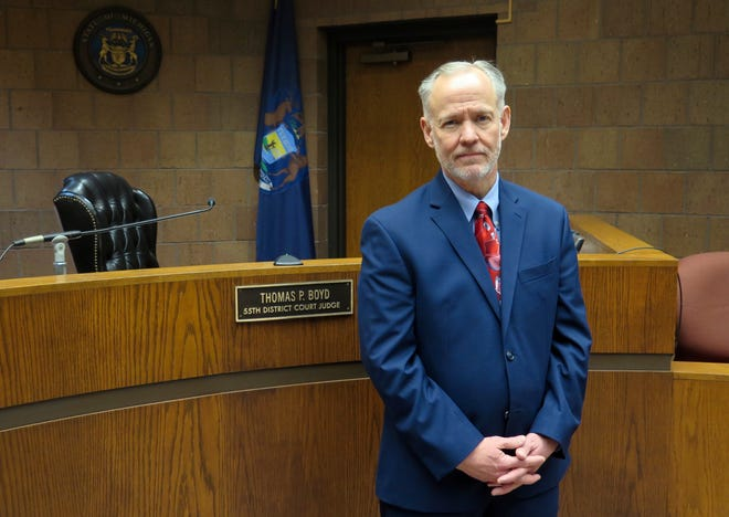 In this Wednesday, Nov. 14, 2018, photo, Ingham County District Court Judge Thomas Boyd poses for a photo in his courtroom in Mason, Mich.
