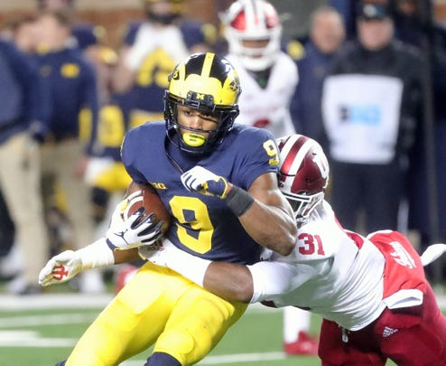 Michigan's Donovan Peoples-Jones is tackled by Indiana's Bryant Fitzgerald during the second half Saturday, Nov. 17, 2018 at Michigan Stadium in Ann Arbor.