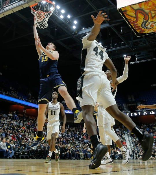 Michigan center Jon Teske makes a basket in the second half of the 66-47 win over Providence on Sunday, Nov. 18, 2018, at Mohegan Sun Arena.