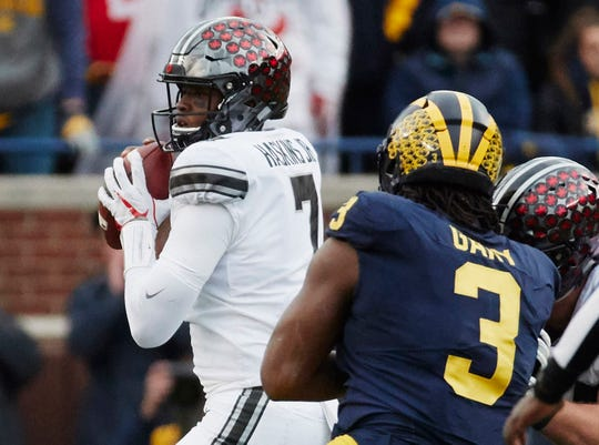 Ohio State quarterback Dwayne Haskins looks to pass in the second half against Michigan at Michigan Stadium, Nov. 25, 2017.