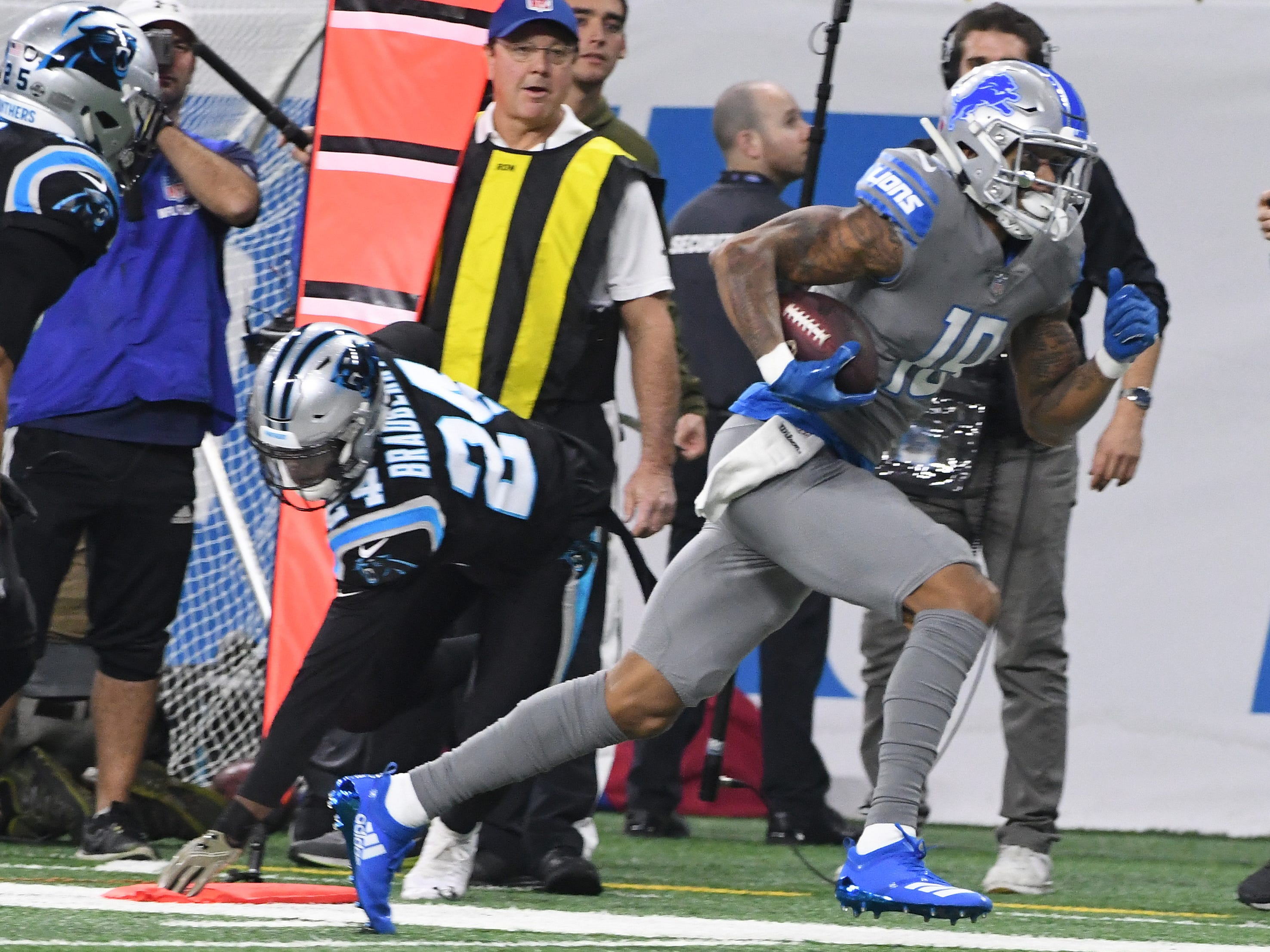 Lions' Kenny Golladay picks up extra yardage after pulling down a reception over Panthers' James Bradberry in the first quarter.