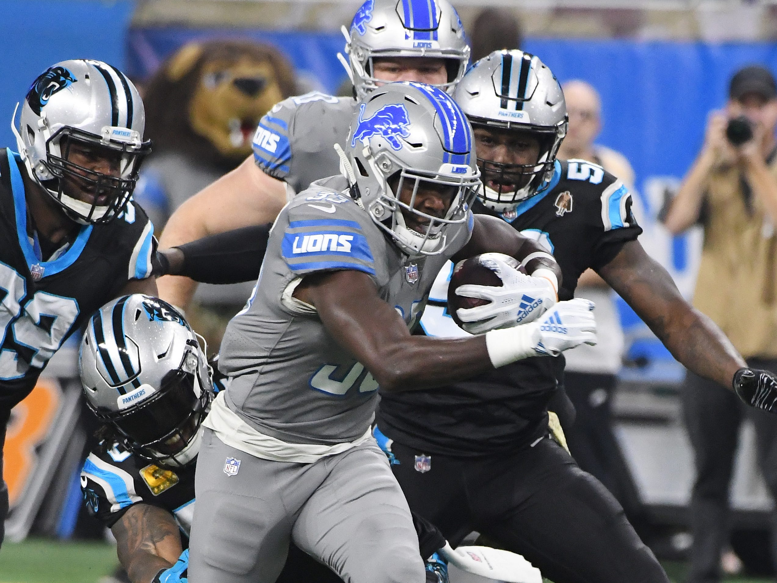 Lions running back Kerryon Johnson races up field in the first quarter.