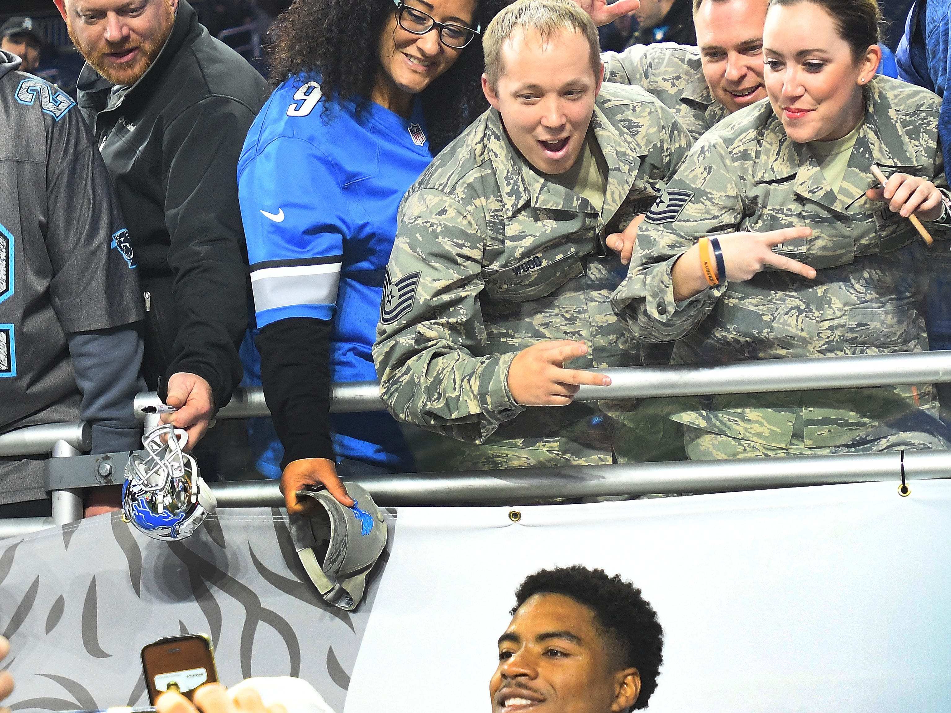 U.S. Air Force technical sergeants Josh Wood, Zachary Carey and Holly Graham gets a selfie with Detroit Lions cornerback DeShawn Shead before the NFL Salute to Service game against the Carolina Panthers.
