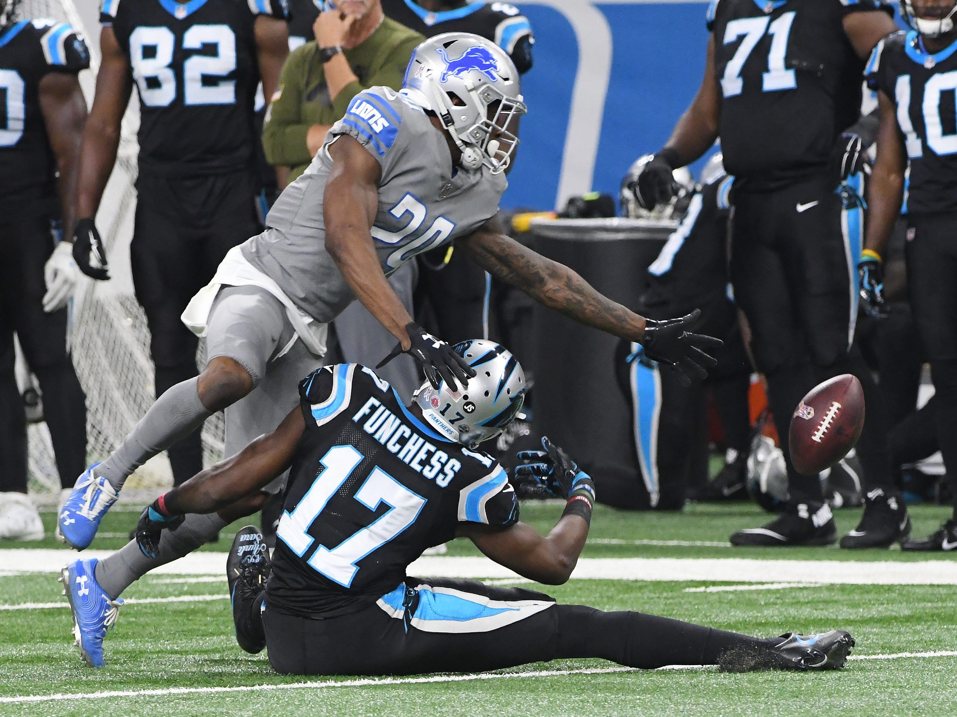 Lions' Nevin Lawson tries to grab an interception on a bobbled pass to Panthers' Devin Funchess  in the second quarter.