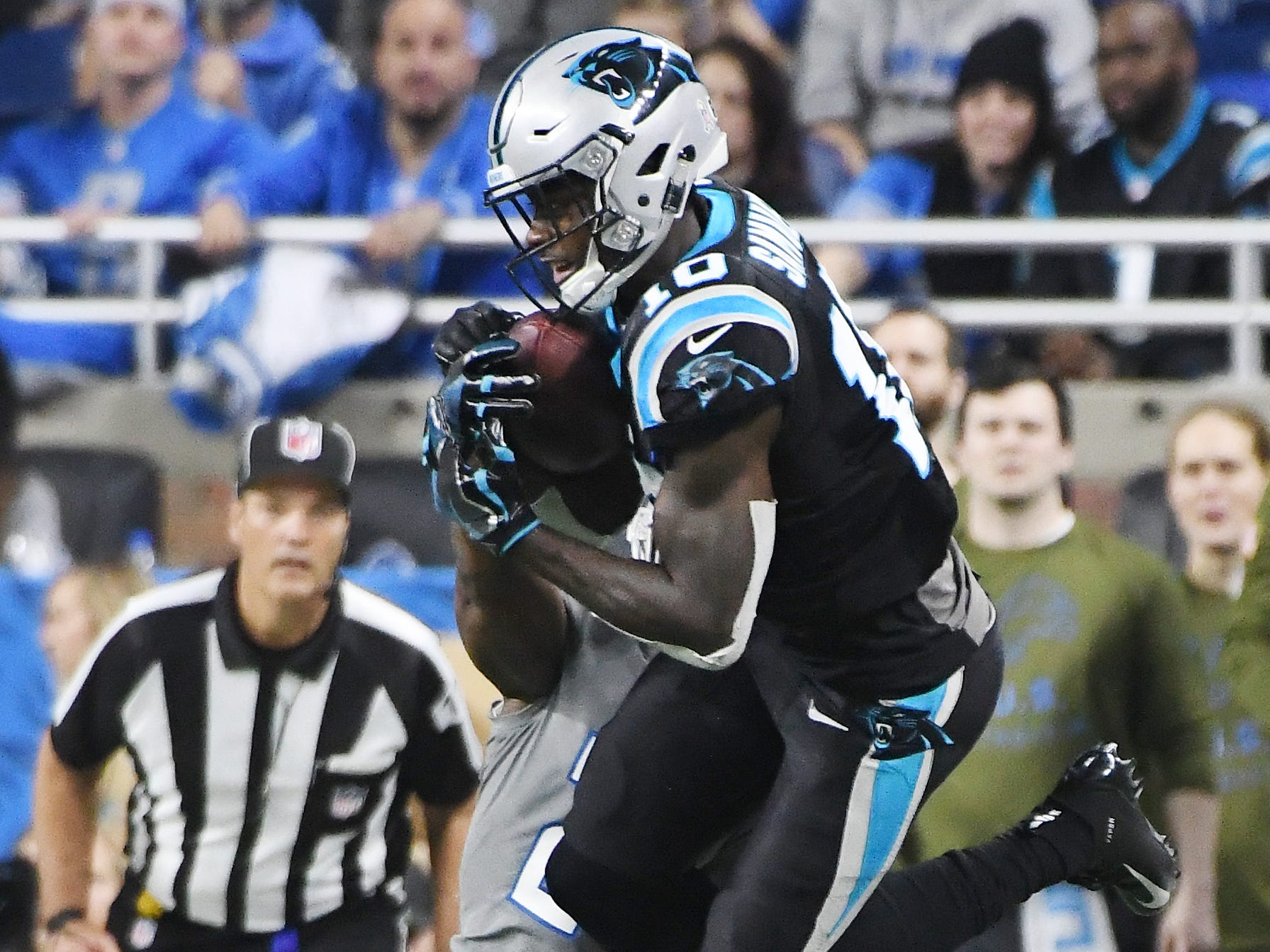 Panthers wide receiver Curtis Samuel pulls in a reception over Lions' Nevin Lawson late in the fourth quarter.