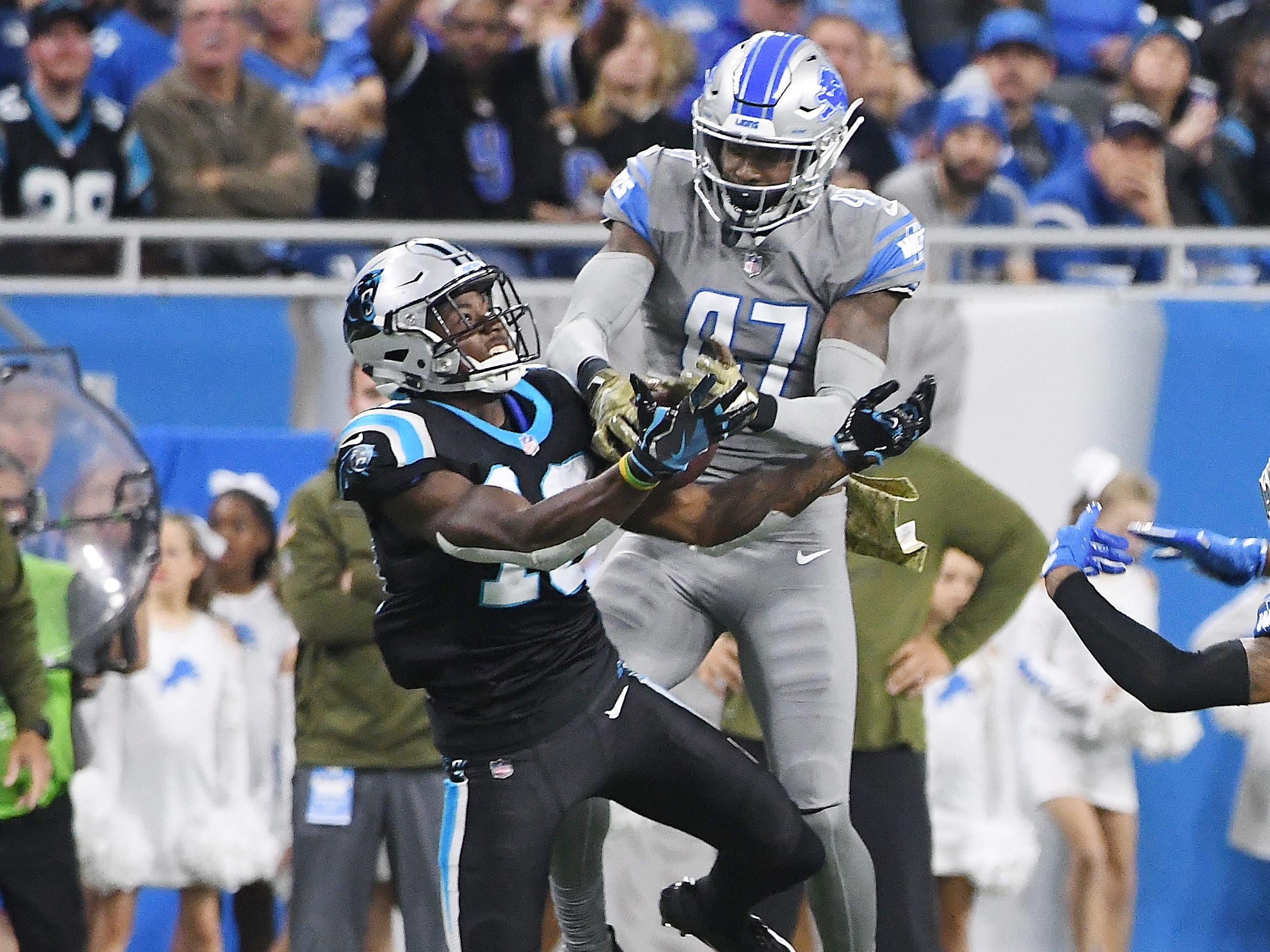 Lions defensive back Tracy Walker rips away a reception from Panthers receiver Curtis Samuel for the interception late in the second quarter.