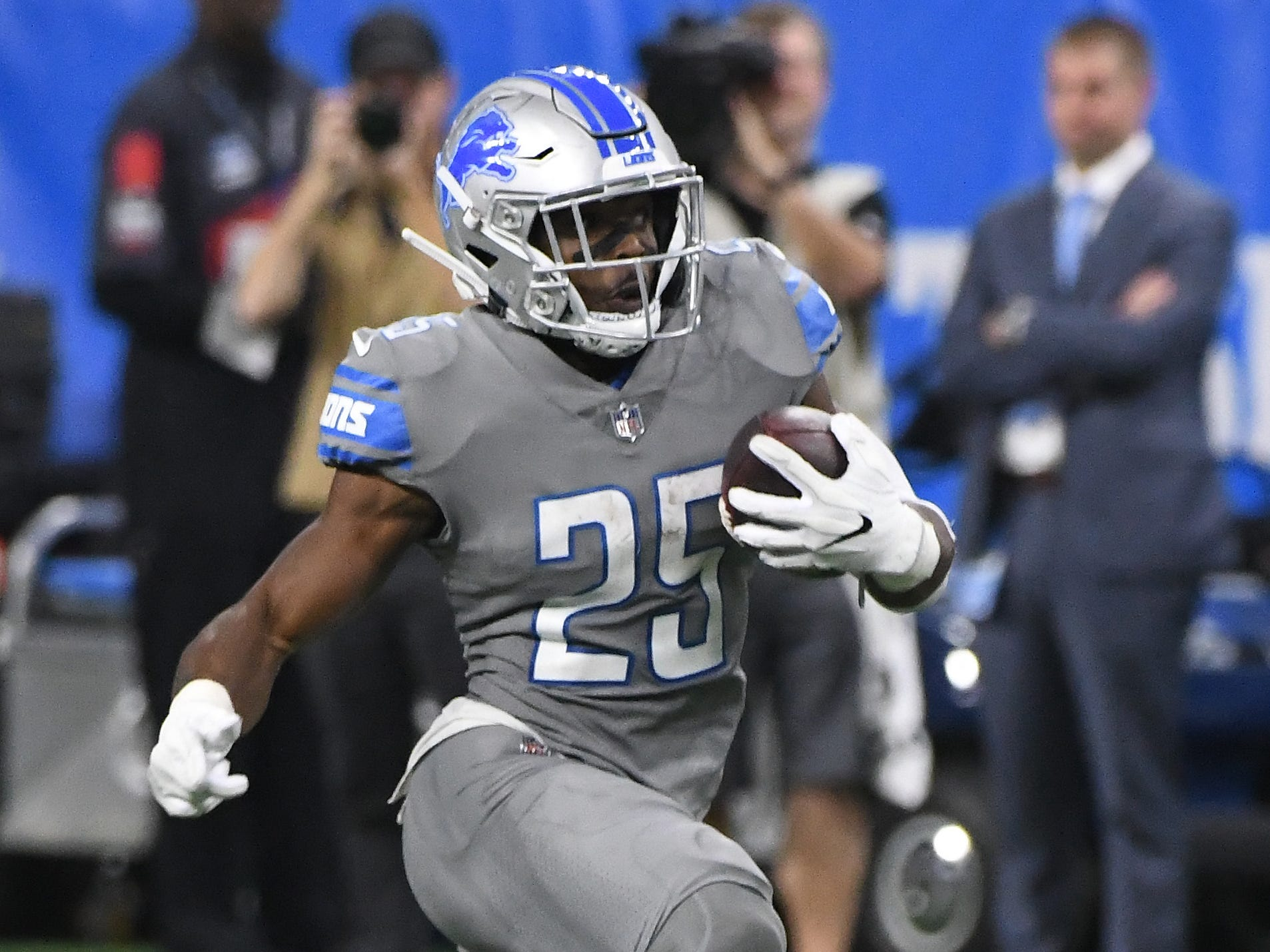 Lions running back Theo Riddick finds some open room for a first down run in the fourth quarter.