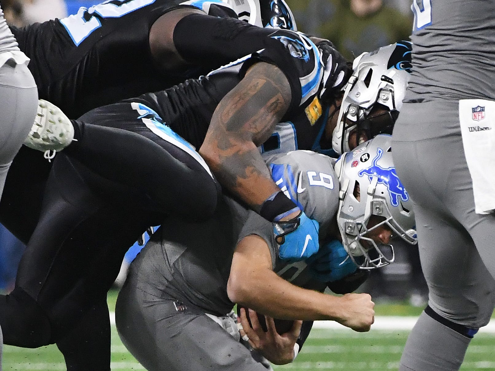 Panthers' Vernon Butler and Julius Peppers sack Lions quarterback Matthew Stafford in the fourth quarter.