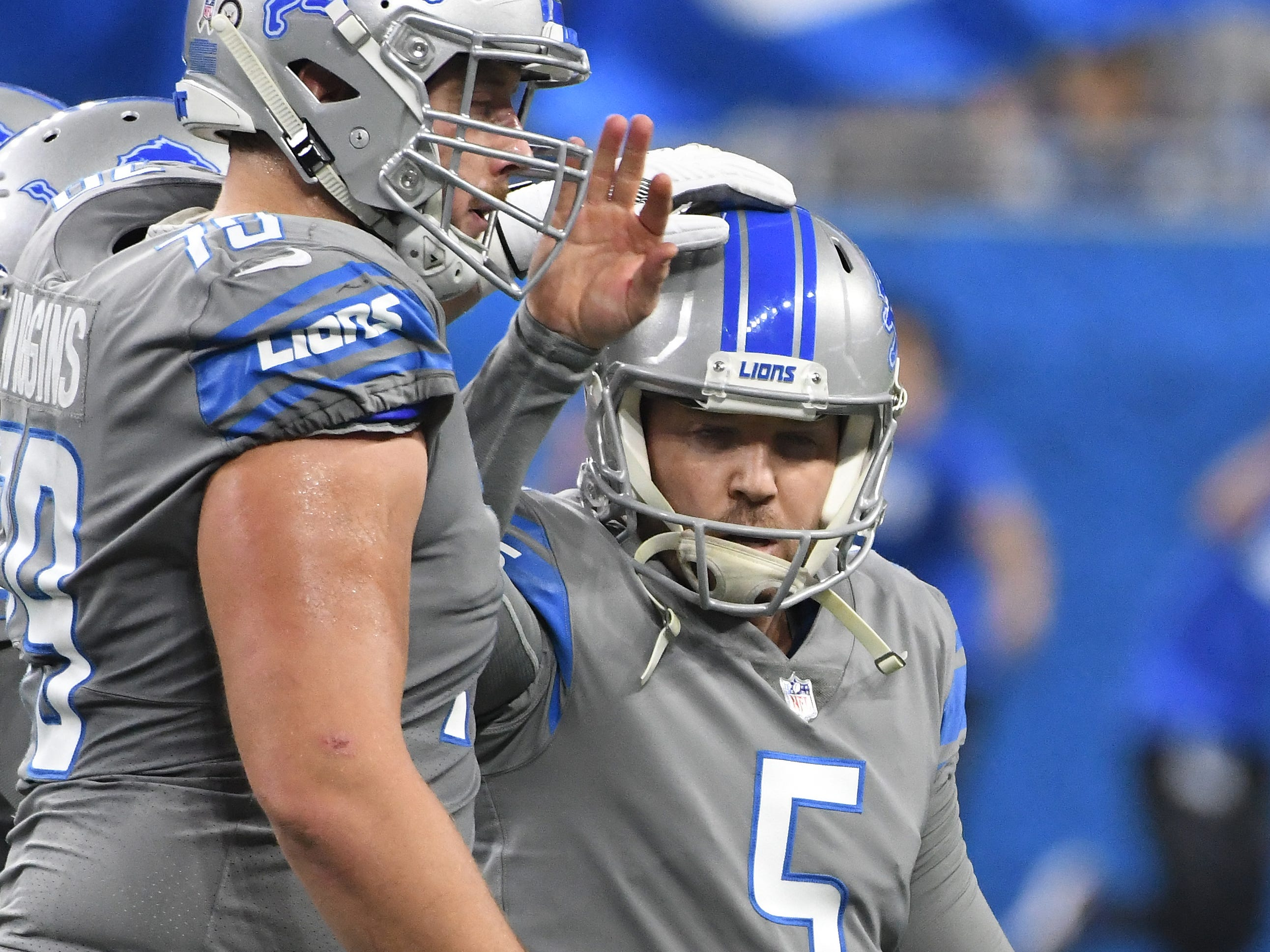 Lions kicker Matt Prater celebrates with teammates after making a field goal in the second quarter to go up 10-7.