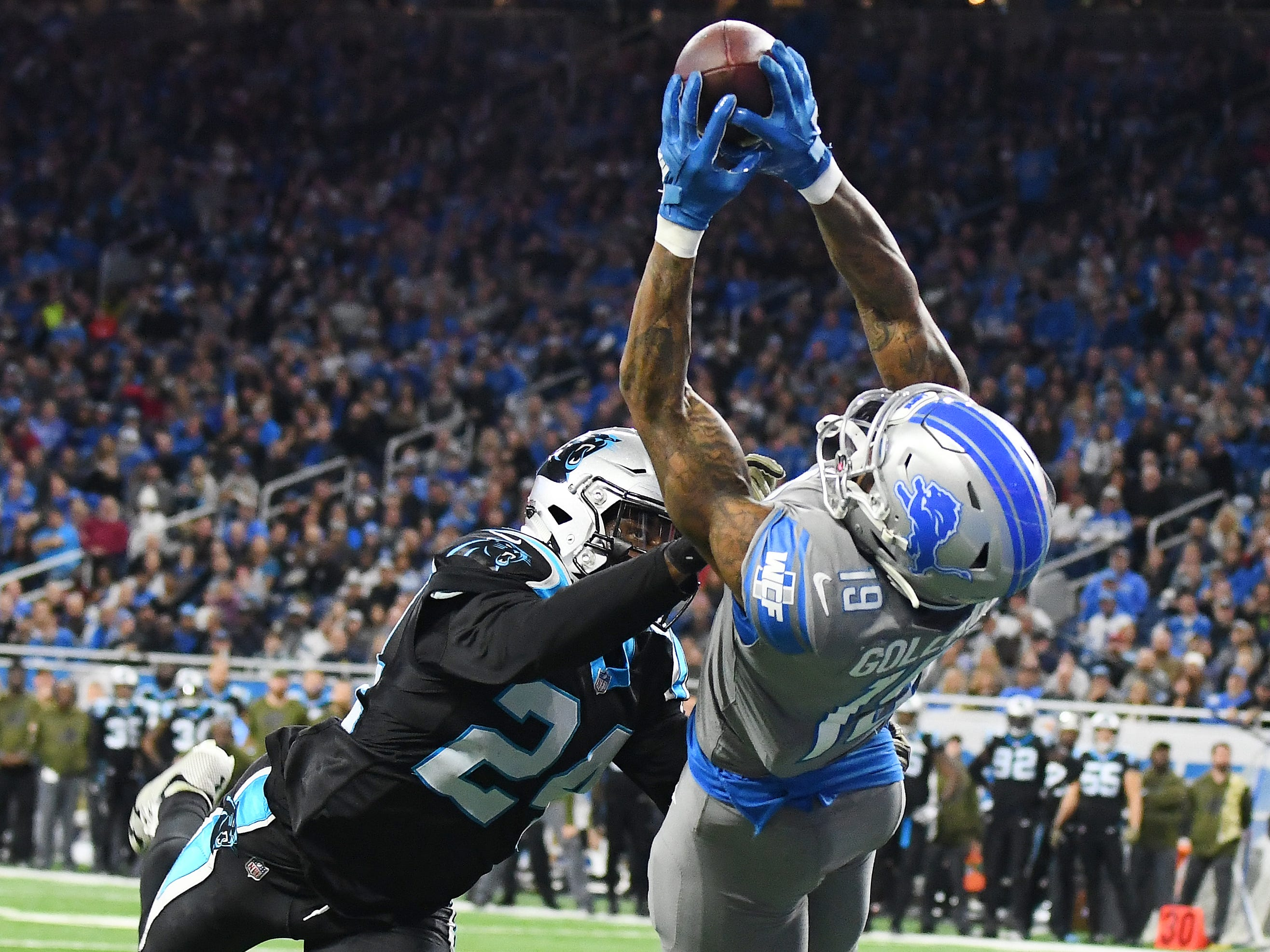 Lions wide receiver Kenny Golladay makes the winning touchdown catch in front of Panthers cornerback James Bradberry late in the fourth quarter.