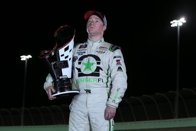 Tyler Reddick, driver of the No. 9 Chevrolet, poses for a photo after winning the NASCAR Xfinity Series Ford EcoBoost 300.