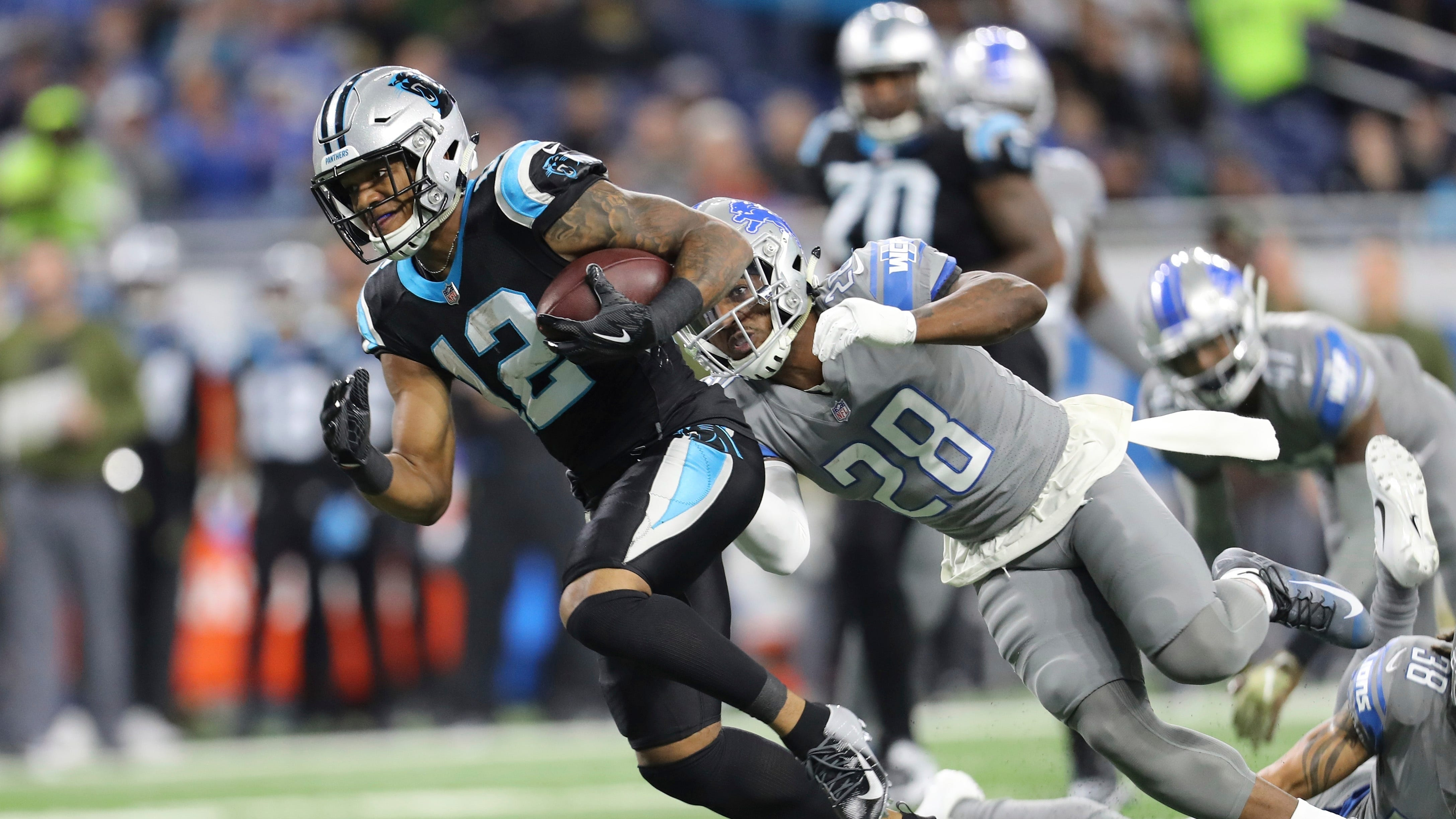 Carolina Panthers wide receiver DJ Moore is chased by Detroit Lions strong safety Quandre Diggs during the first quarter.
