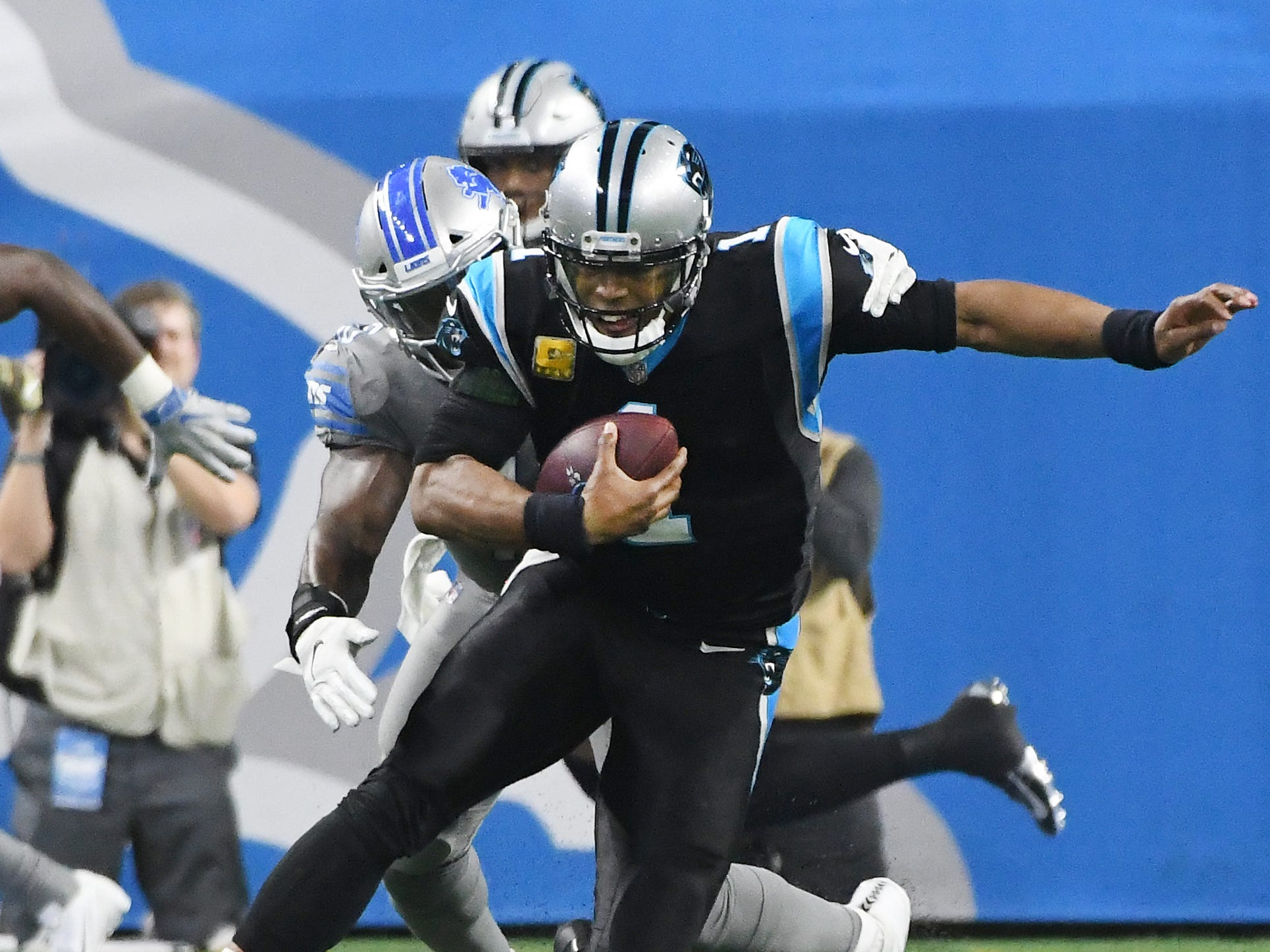 Lions' Jarrad Davis brings down Panthers quarterback Cam Newton for a sack in the third quarter.