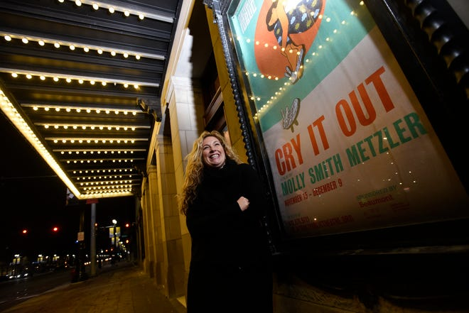 New York playwright Molly Smith Metzler stands next to a poster of her play, Cry It Out, at the Max M. Fisher Music Center in Detroit, Friday, Nov. 16, 2018.