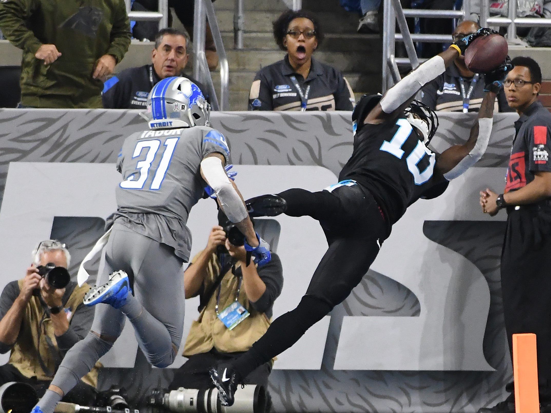 Panthers' Curtis Samuel brings down a touchdown reception in front of Lions' Teez Tabor to tie the game at 13 with a failed extra point attempt keeping the teams tied in the fourth quarter.