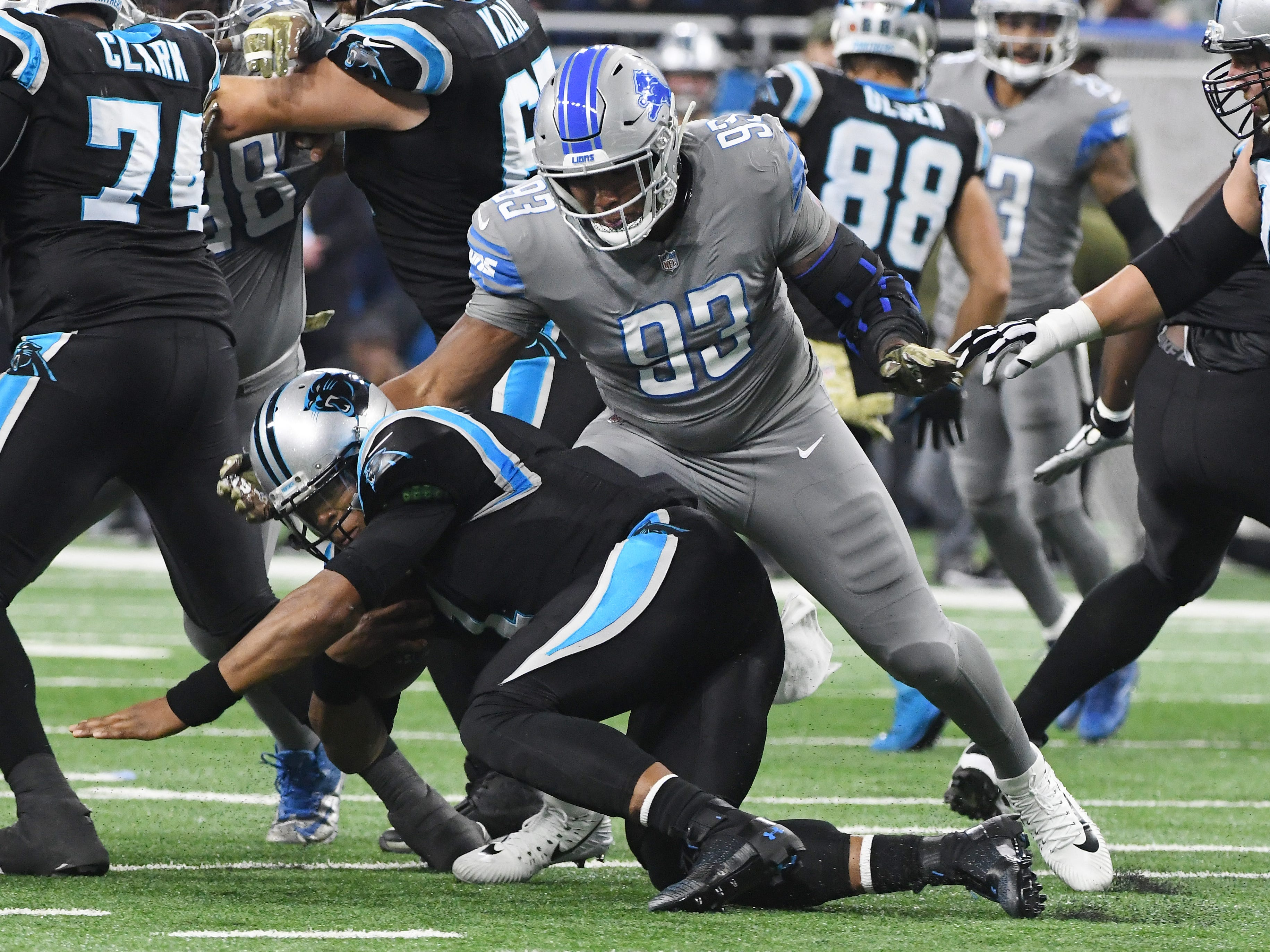 Lions' Da' Shawn Hand sacks Panthers quarterback Cam Newton in the first quarter.