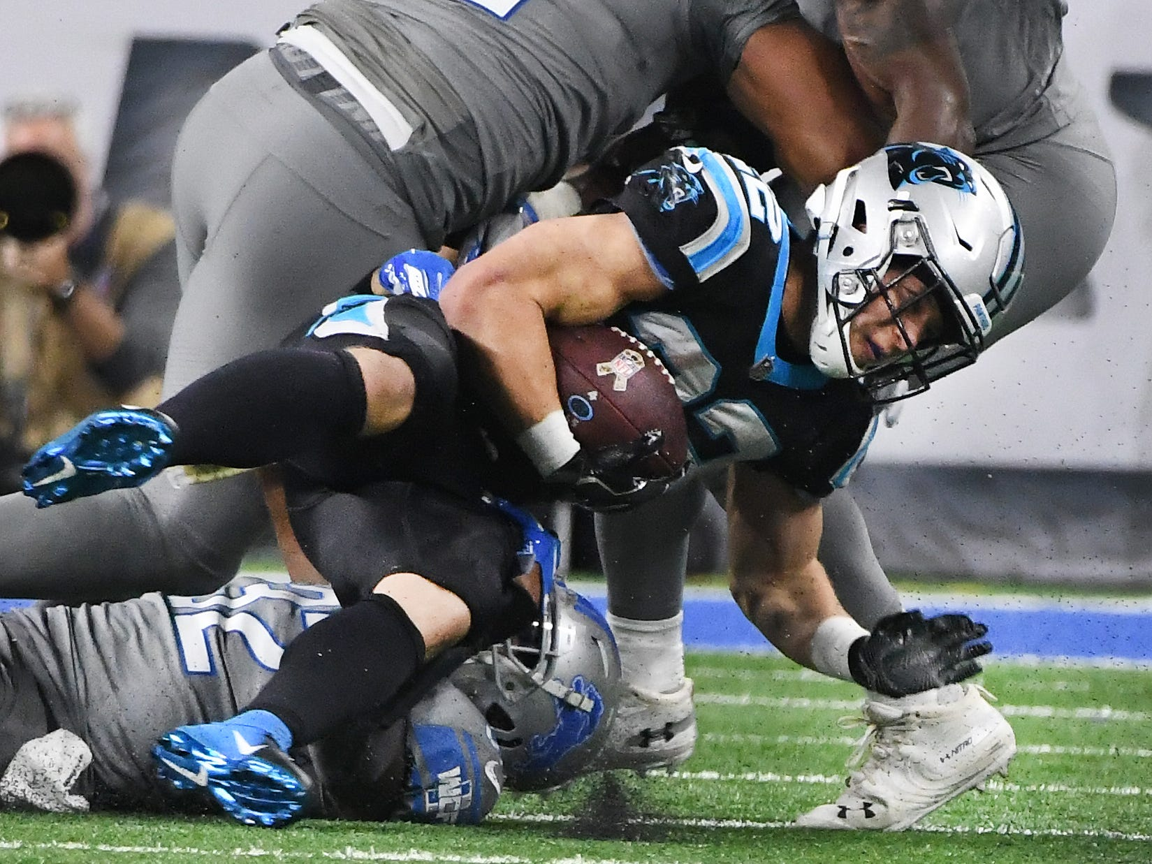 Lions defense including Tavon Wilson and Detroit's defense bring down Panthers running back Christian McCaffrey in the fourth quarter.