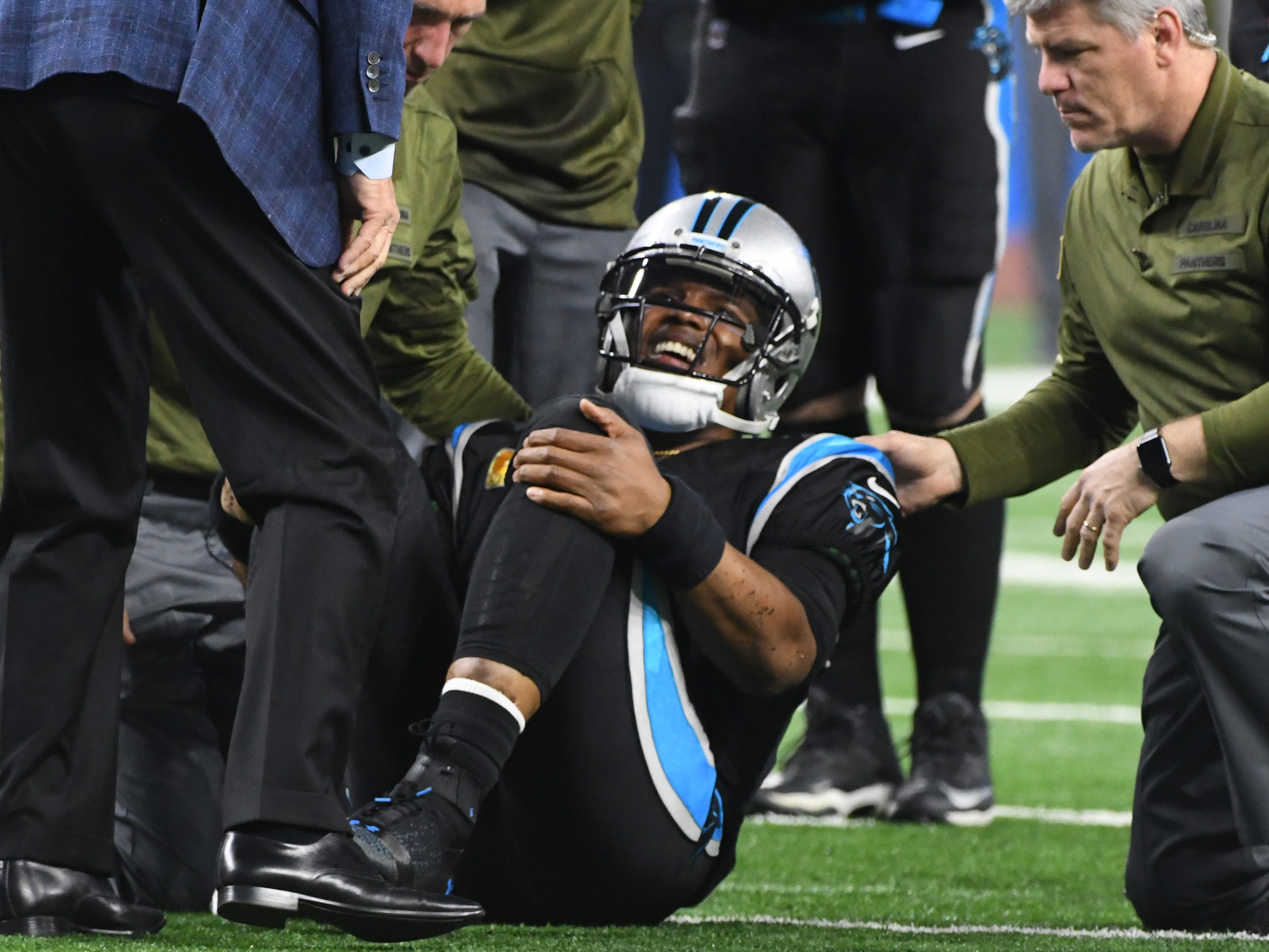 Panthers quarterback Cam Newton is slow to get up after a hit in the third quarter.