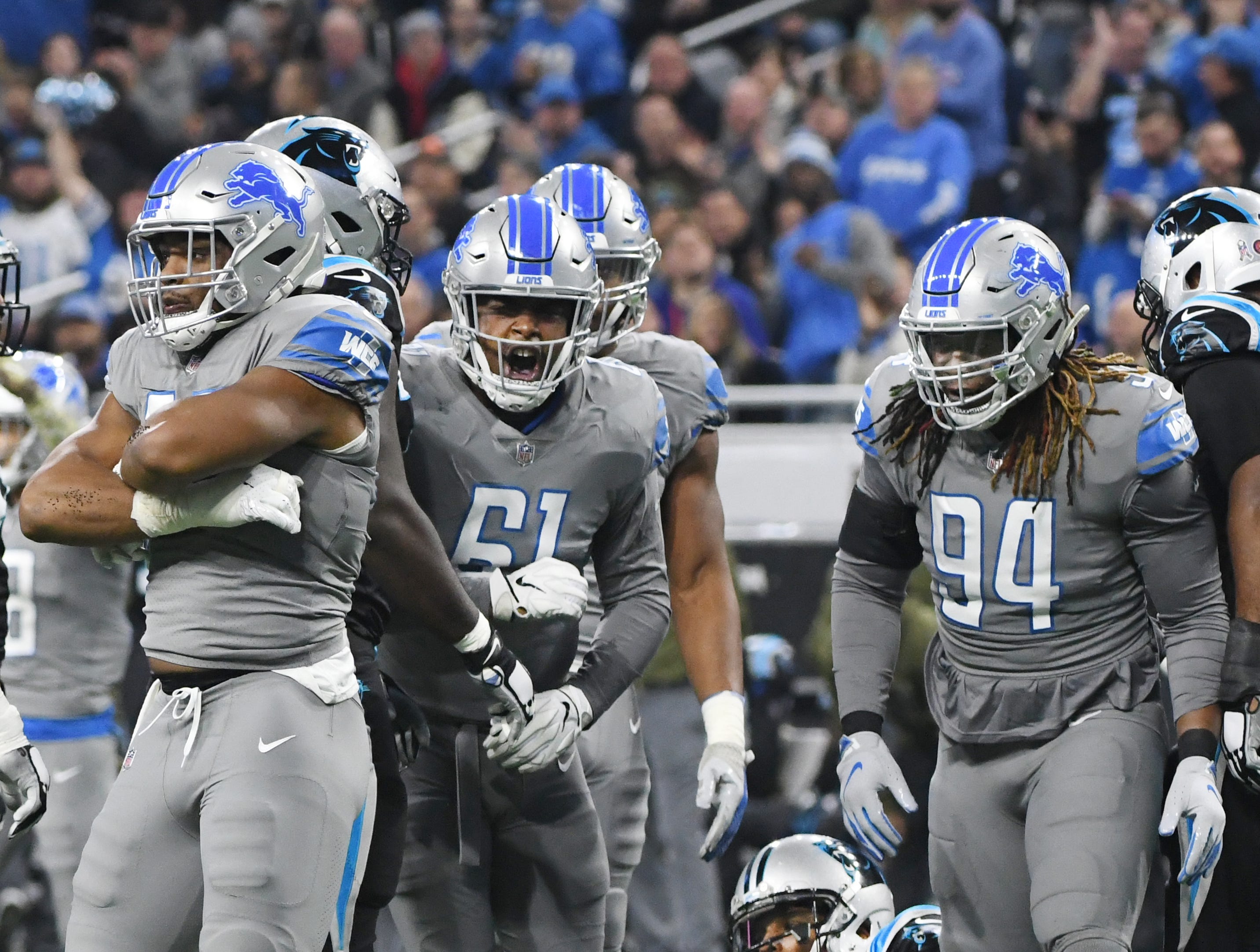 The Lions defense celebrates after teammate Da'Shawn Hands sacks Panthers quarterback Cam Newton, on the ground, in the first quarter.