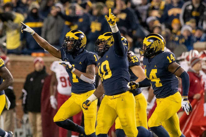 From left, Michigan defensive back Ambry Thomas, linebacker Devin Bush (10), and defensive back Josh Metellus celebrate after the defense held off a fourth-down attempt by Indiana in the fourth quarter.