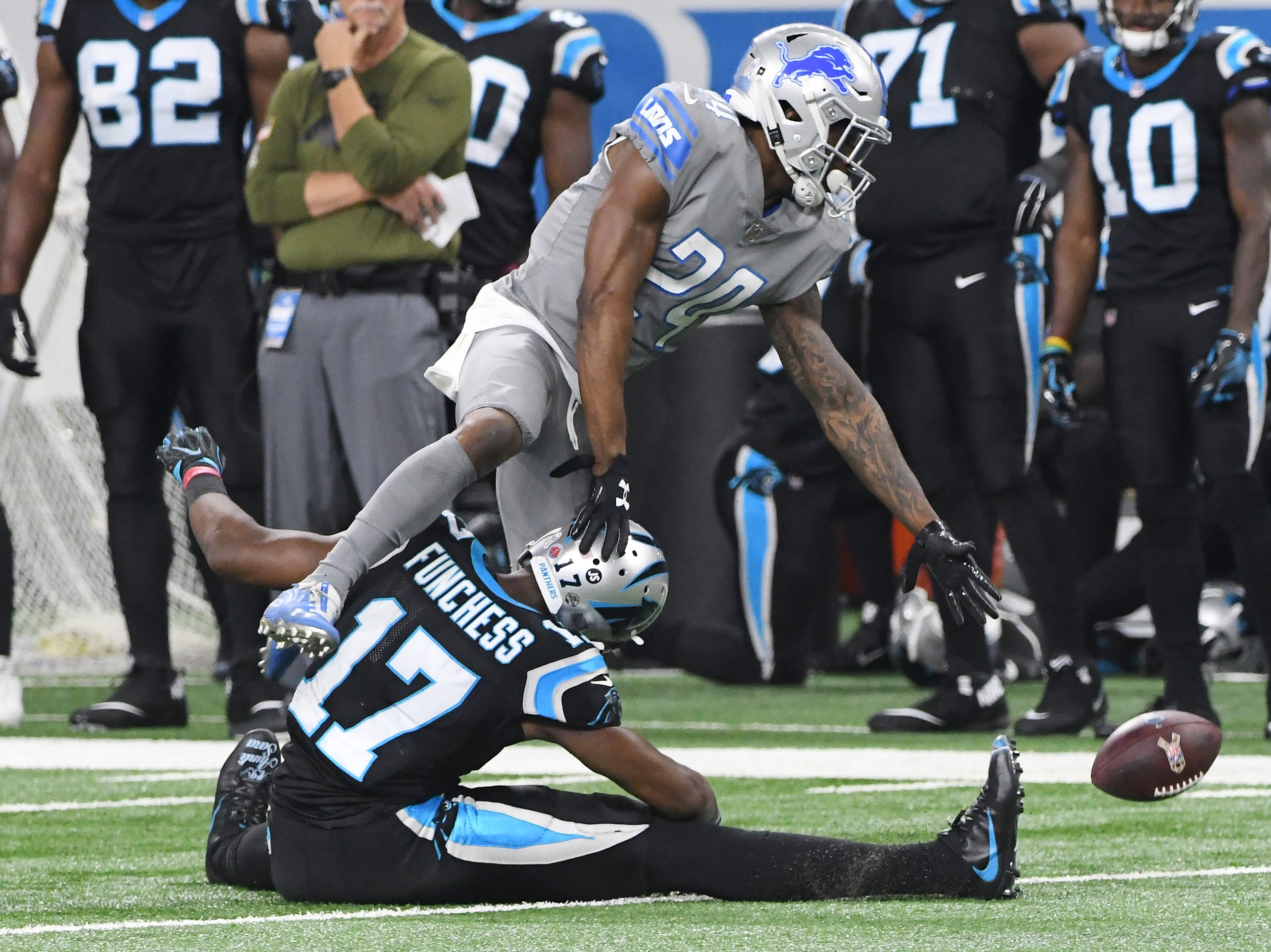 Lions cornerback Nevin Lawson tries to grab an interception on a bobbled pass to Panthers receiver Devin Funchess (Michigan) in the second quarter.