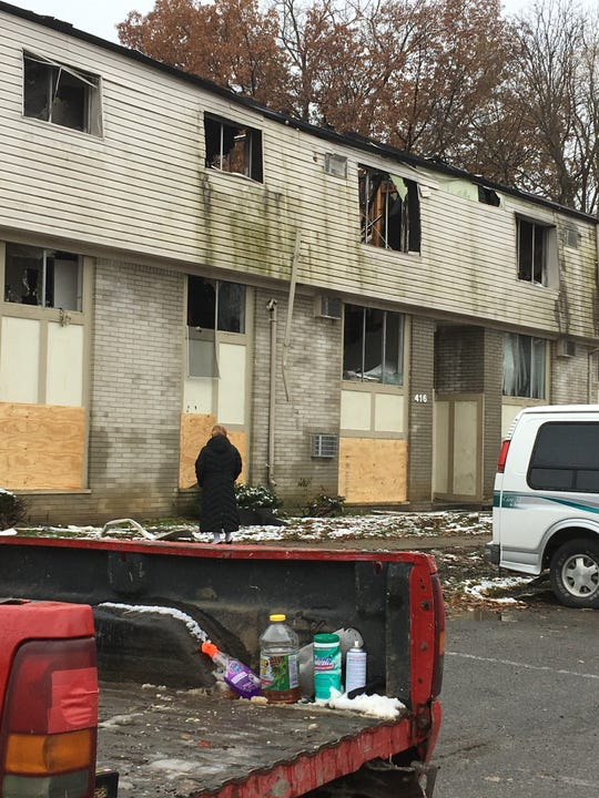 Fire destroyed 23 units at the Canterbury Woods apartment in Inkster. Apartment maintenance crews were on the property Sunday to cleanup .