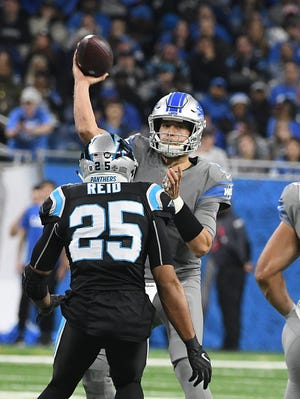 Lions quarterback Matthew Stafford wore a wrist band to help with play calls on Sunday.