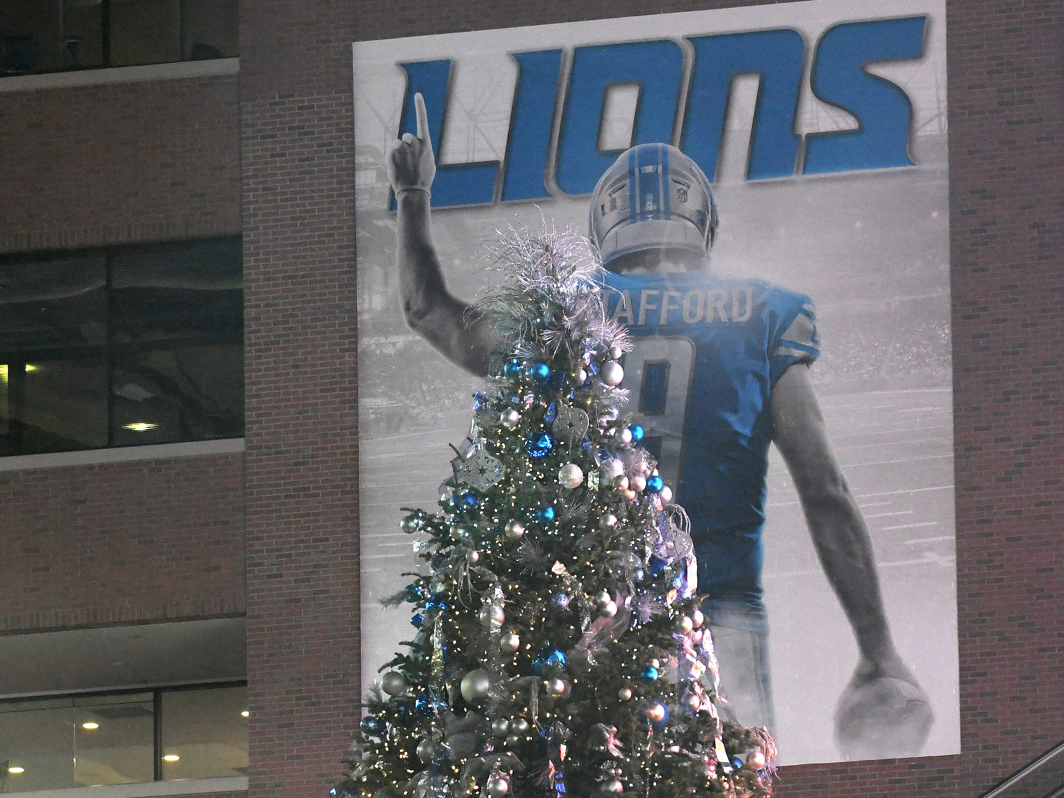 Ford Field's Christmas tree is lit before the Lions take on the Carolina Panthers.
