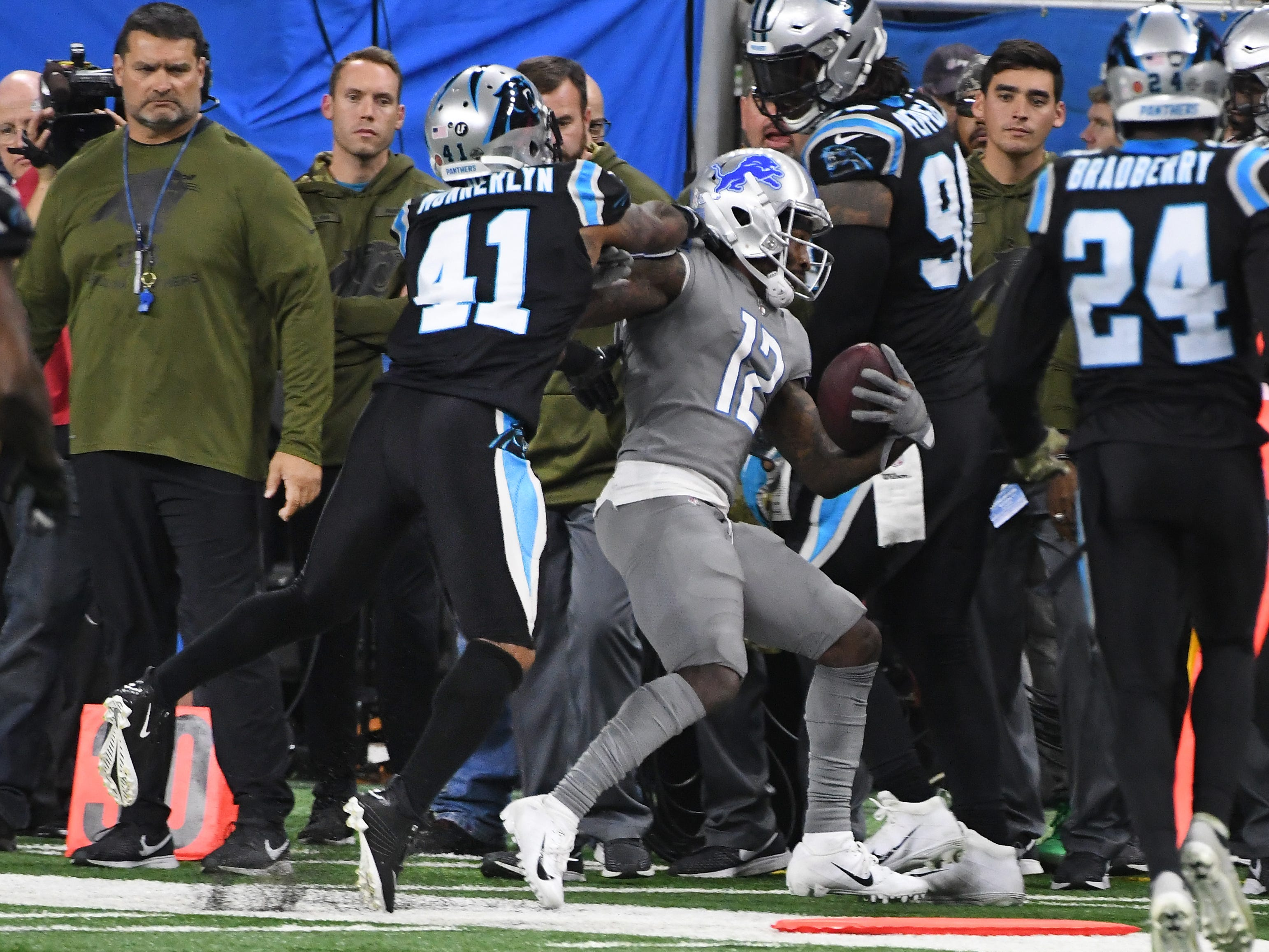 Panthers' Captain Munnerlyn pushes Lions wide receiver Bruce Ellington out of bounds and maybe beyond that but it was ruled a fair play in the fourth quarter.