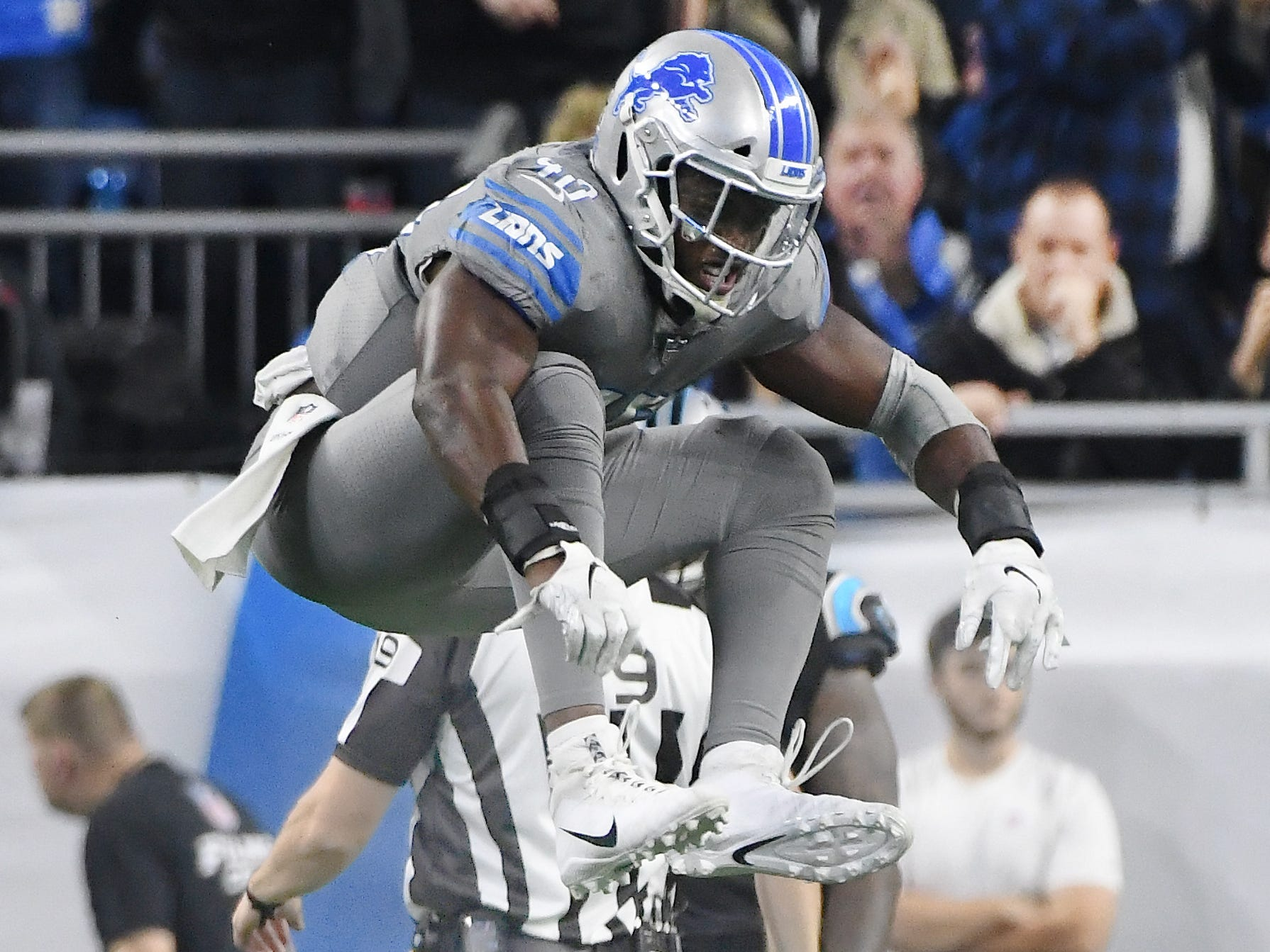 Lions linebacker Jarrad Davis celebrates a sack on Panthers quarterback Cam Newton in the third quarter.