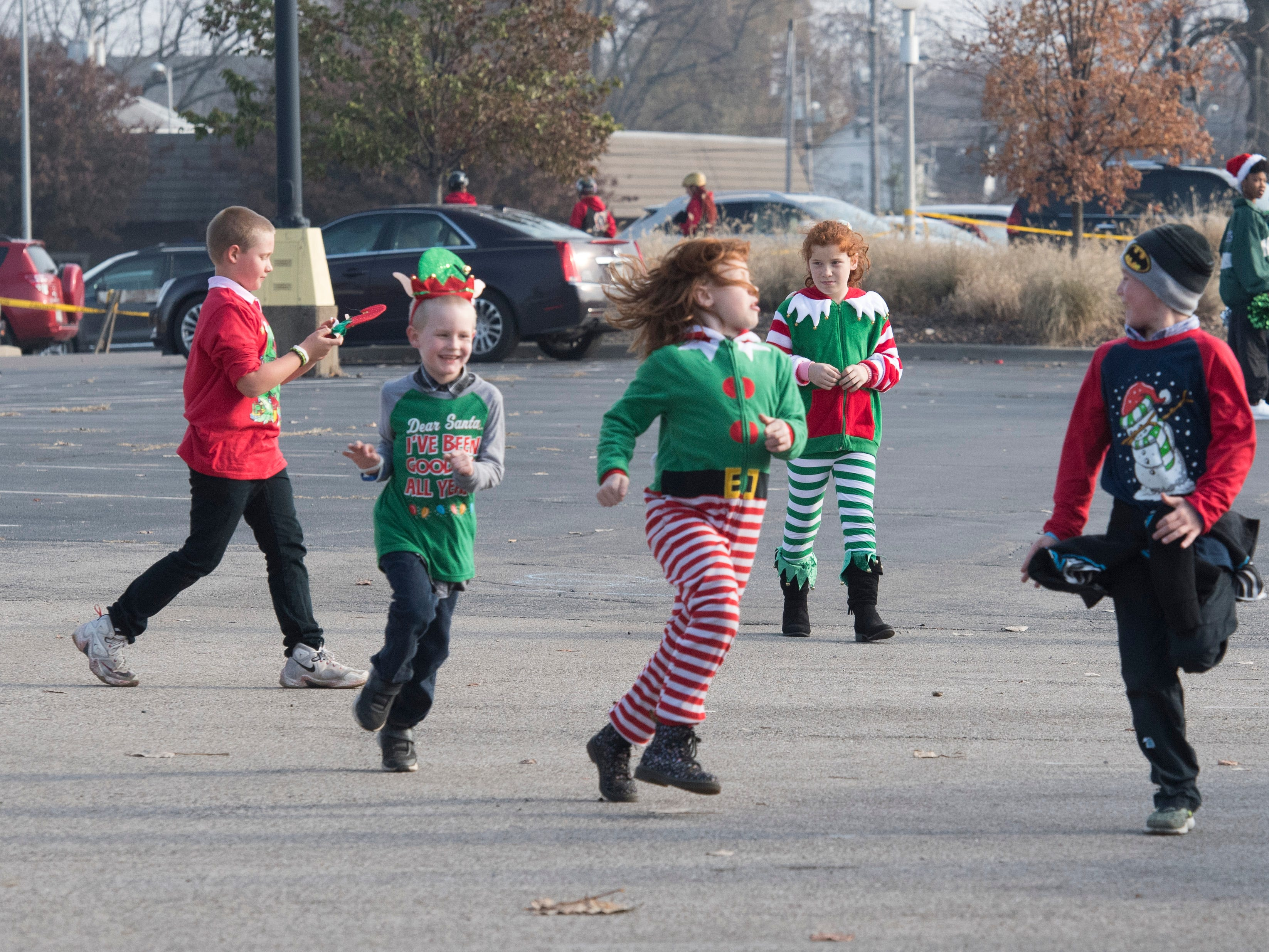 Kids run around the back forty parking lot before Evansville's Christmas on North Main Parade Sunday, Nov. 18, 2018.