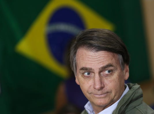 Brazilian Presidential Candidate Jair Bolsonaro Votes In Country S Election
