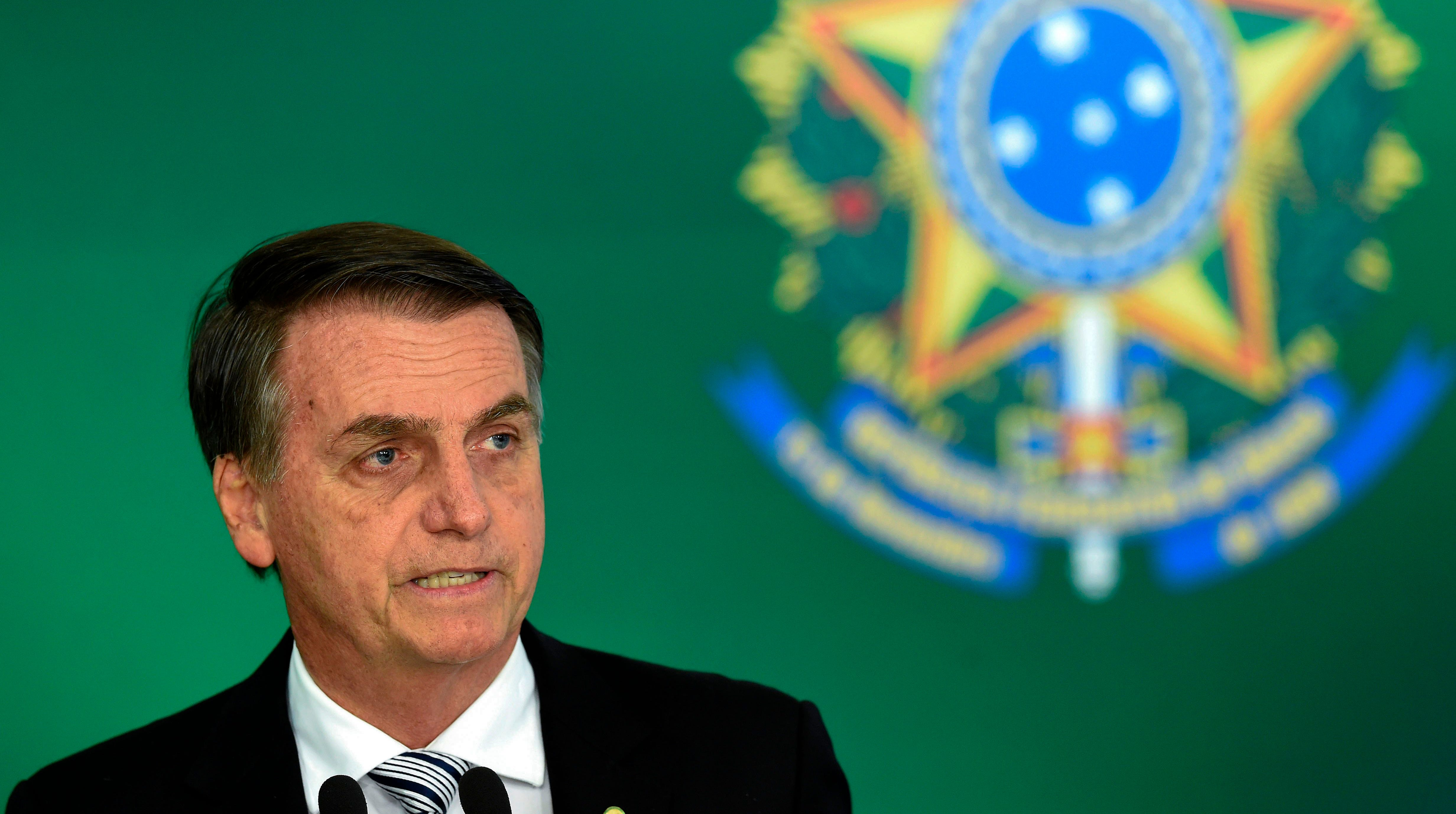 Brazilian president-elect Jair Bolsonaro delivers a joint press conference with Brazilian President Michel Temer (out of frame) after a meeting in Brasilia on Nov. 7, 2018.