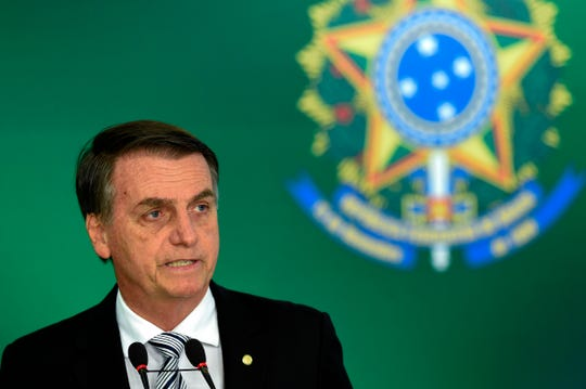 """Brazilian President Jair Bolsonaro, dubbed the """"Trump of the Tropics,"""" arrives at the White House on Tuesday for a meeting with President Donald Trump."""