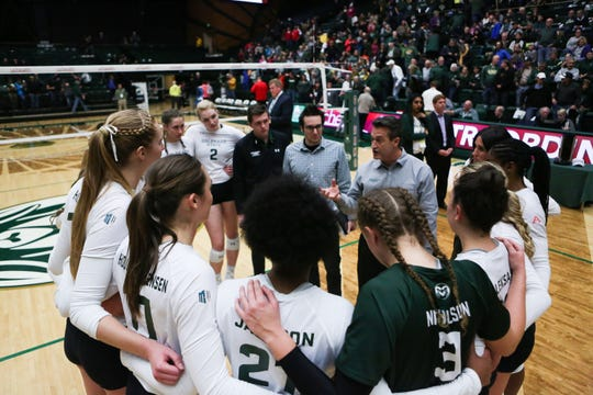 CSU volleyball coach Tom Hilbert, shown talking to his team before a Nov. 17, 2018, match against New Mexico, announced the addition of two players Monday -- libero Alexa Roumeliotis, a transfer from Creighton, and middle blocker Alana Giles, a freshman from Conifer High School.