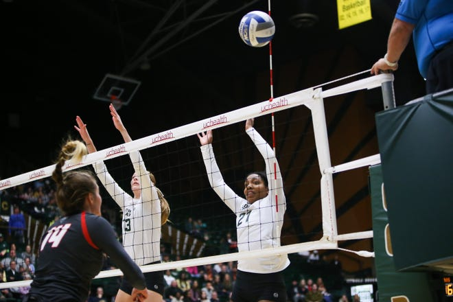 CSU's Kirstie Hillyer and Jessica Jackson put up a successful block during the Rams' loss to New Mexico on Saturday night at Moby Arena.