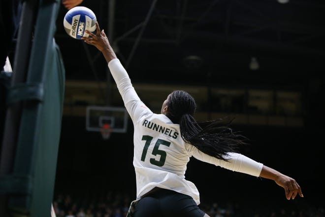 CSU's Breana Runnels tips the ball over the net in a file photo. Runnels had 14 kills in a win over Nevada Saturday.