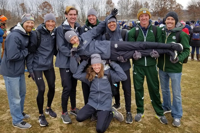 CSU cross country coach Art Siemers far left and his team celebrate finishing ninth at nationals.