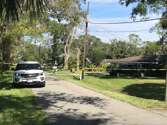 The home where Elwood Robinson was living was a crime scene Sunday morning after the Olga man was charged with two homicides Saturday.