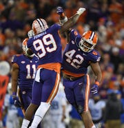 Clemson defensive lineman Clelin Ferrell (99) and defensive lineman Christian Wilkins (42) celebrates a defensive stop against Duke during the 2nd quarter Saturday, November 17, 2018 at Clemson's Memorial Stadium.