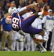 Clemson defensive lineman Clelin Ferrell (99) hits Duke quarterback Daniel Jones (17).