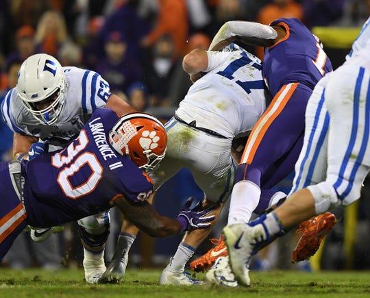 Clemson safety Isaiah Simmons (11) sacks Duke quarterback Daniel Jones (17) during the 1st quarter Saturday, November 17, 2018 at Clemson's Memorial Stadium.