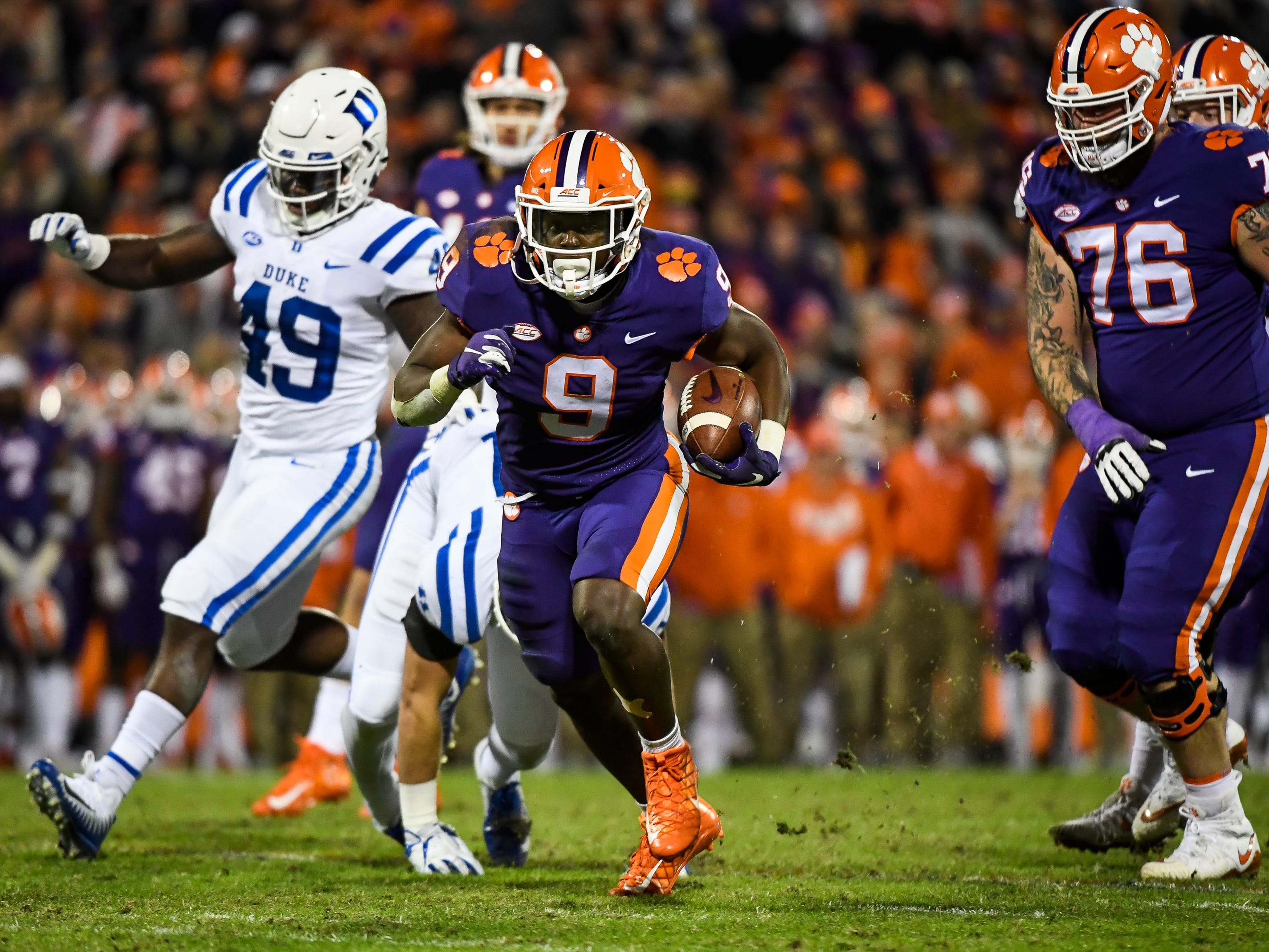 Clemson running back Travis Etienne (9) attempts to advance during their game against Duke at Memorial Stadium on Friday, Nov. 17, 2018.