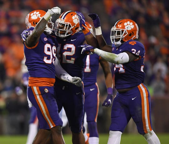 Clemson defensive linemen Clelin Ferrell (99), Christian Wilkins (42), and linebacker Kendall Joseph (34) celebrate a defensive stop against Duke during the 2nd quarter Saturday, November 17, 2018 at Clemson's Memorial Stadium.