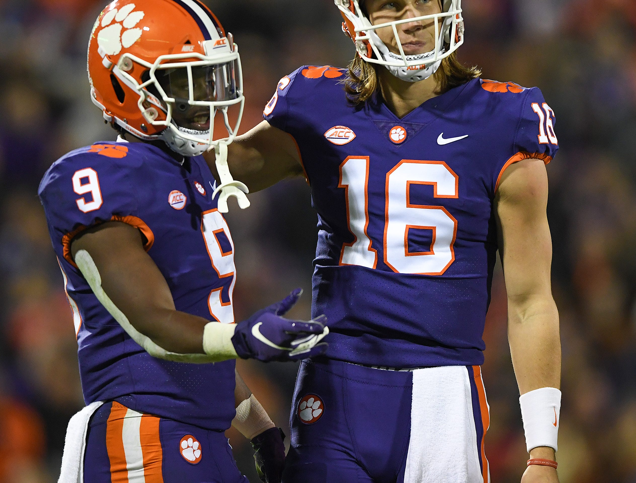 Clemson quarterback Trevor Lawrence (16) with running back Travis Etienne (9) during the 2nd quarter Saturday, November 17, 2018 at Clemson's Memorial Stadium.